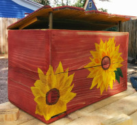 card box, sunflowers, cedar fence slats