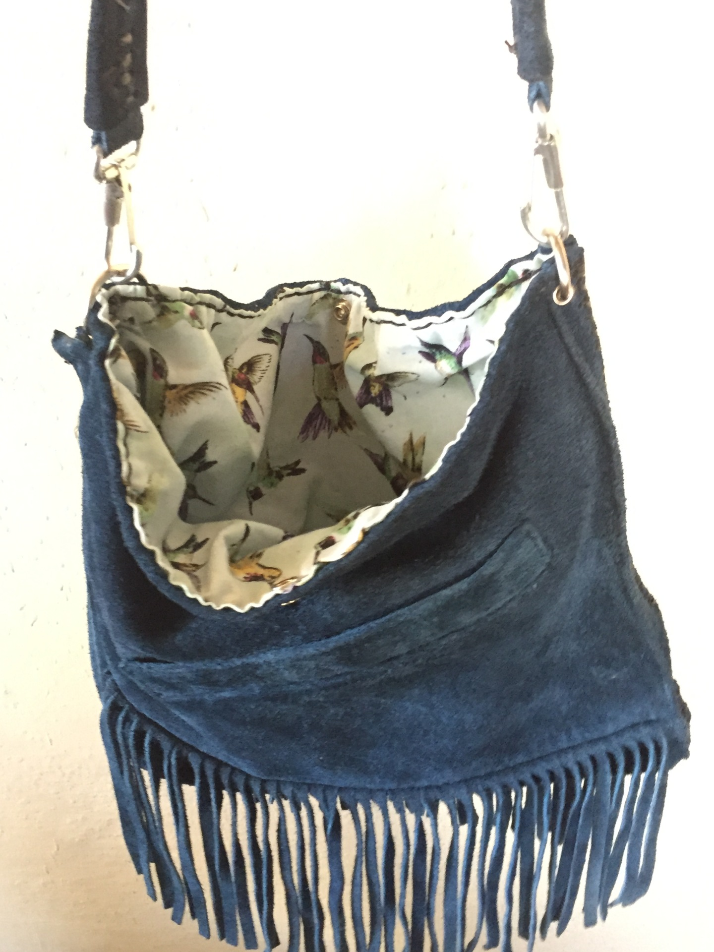 blue purse, purse, fringe, fringe purse, leather, zipper side