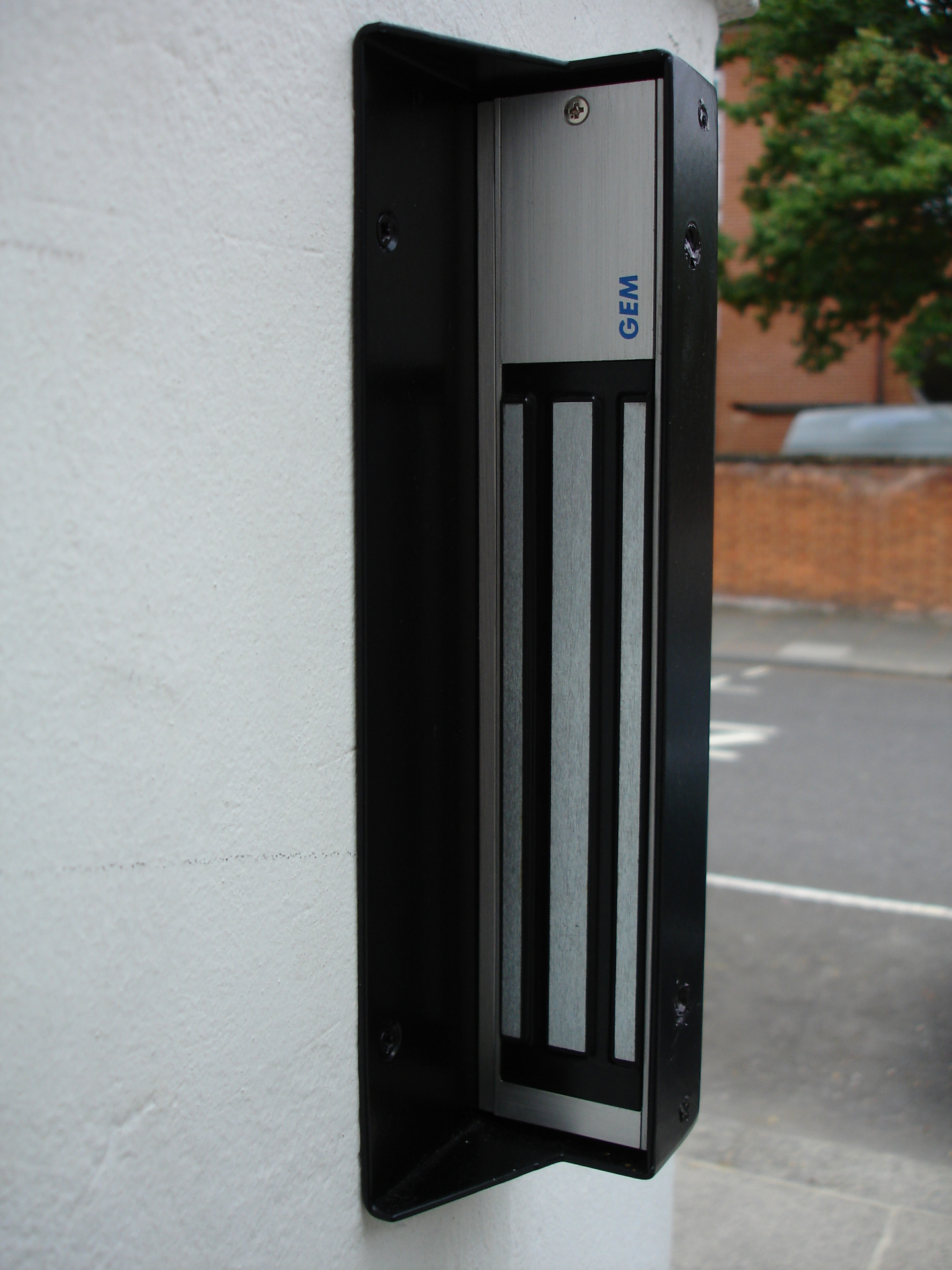 Slimline mag lock for residential property entrance gate