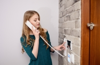 woman using a nes security intercom entry system