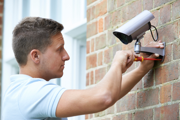nes security worker fixing a cctv camera