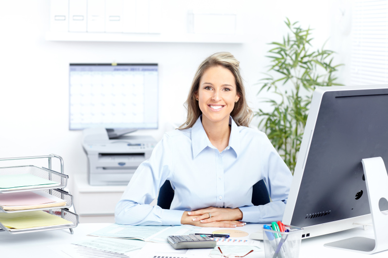 woman in office with computers by nes security