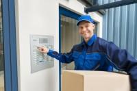 workman using an nes security intercom system