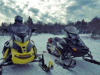 Two snowmobiles on Tug Hill