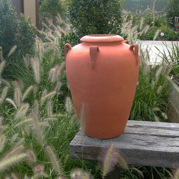 Cantilevered urn over native grasses