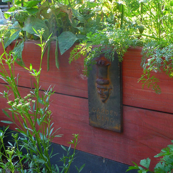 Raised vegetable garden ornament