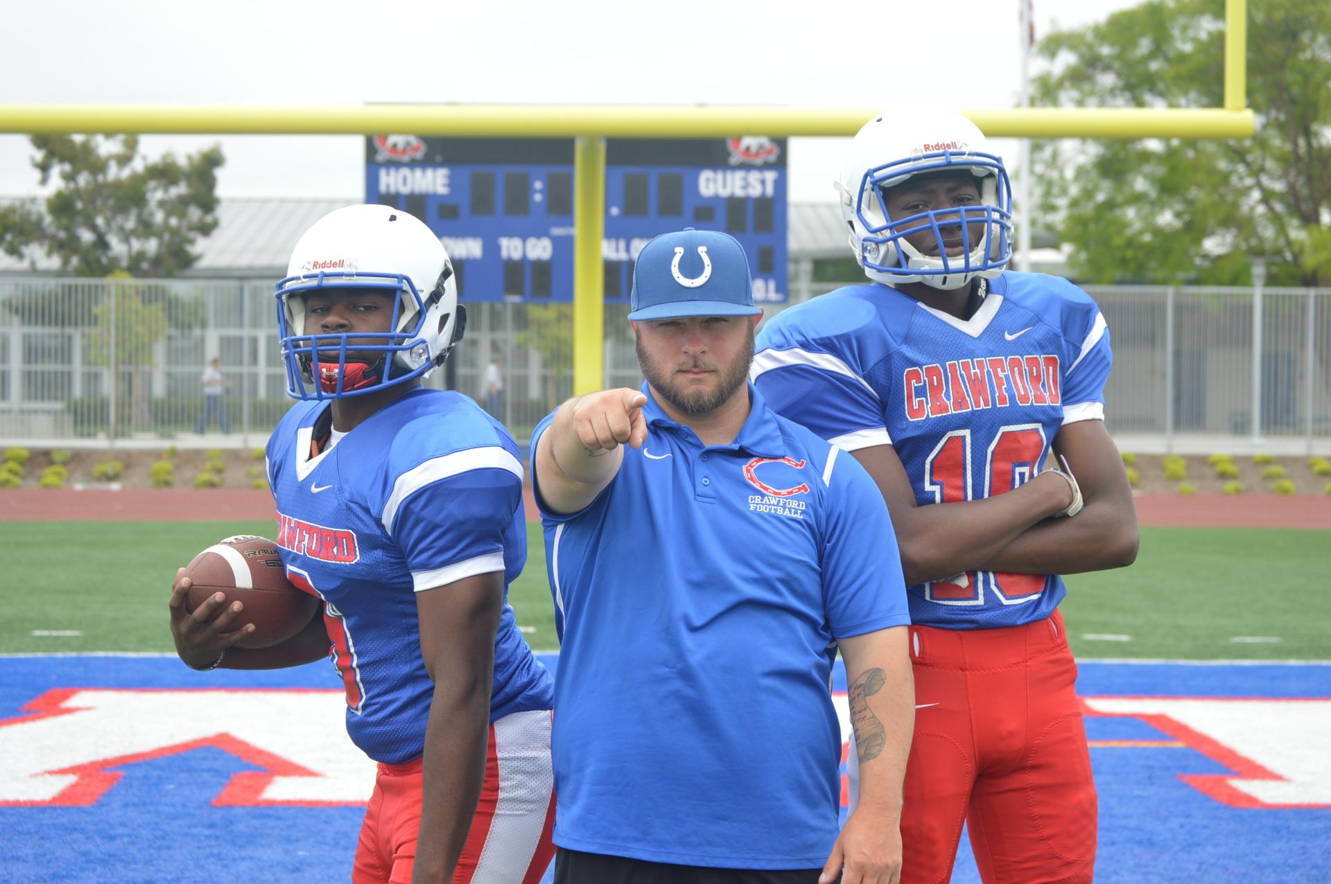 Crawford - LB Marlow Jenkins & WR Malachi Batie with Coach Marquez