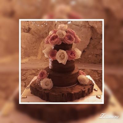 Three Tier Chocolate cake with fresh roses