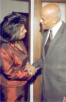Pam greets Harry Belafonte