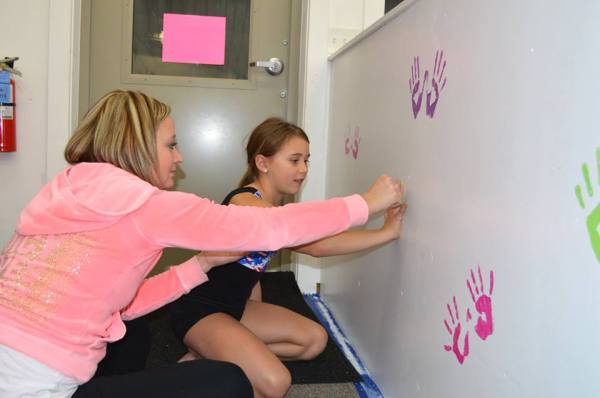 Miss Bobbi & Addy Decorating the Wall at the Pre-Team/Team Sleepover