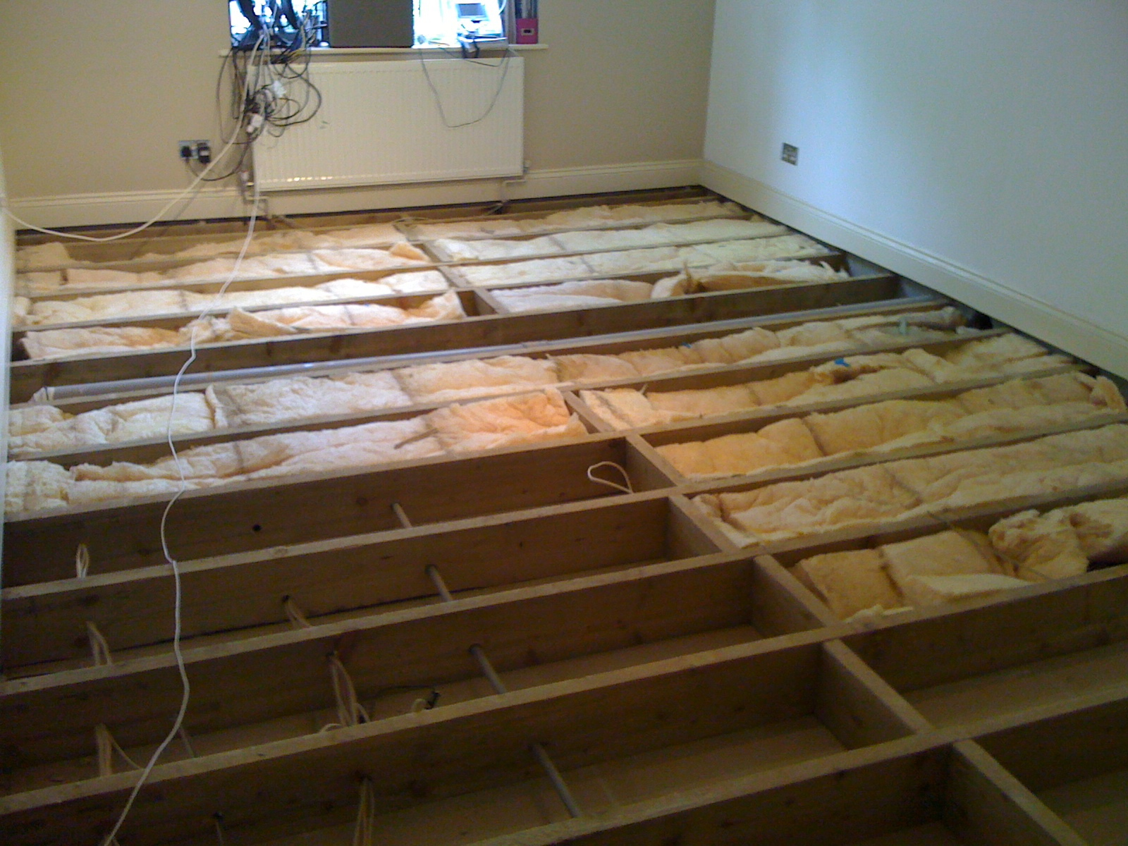 wood worm infested joists and floor boards removed, treated and insulated