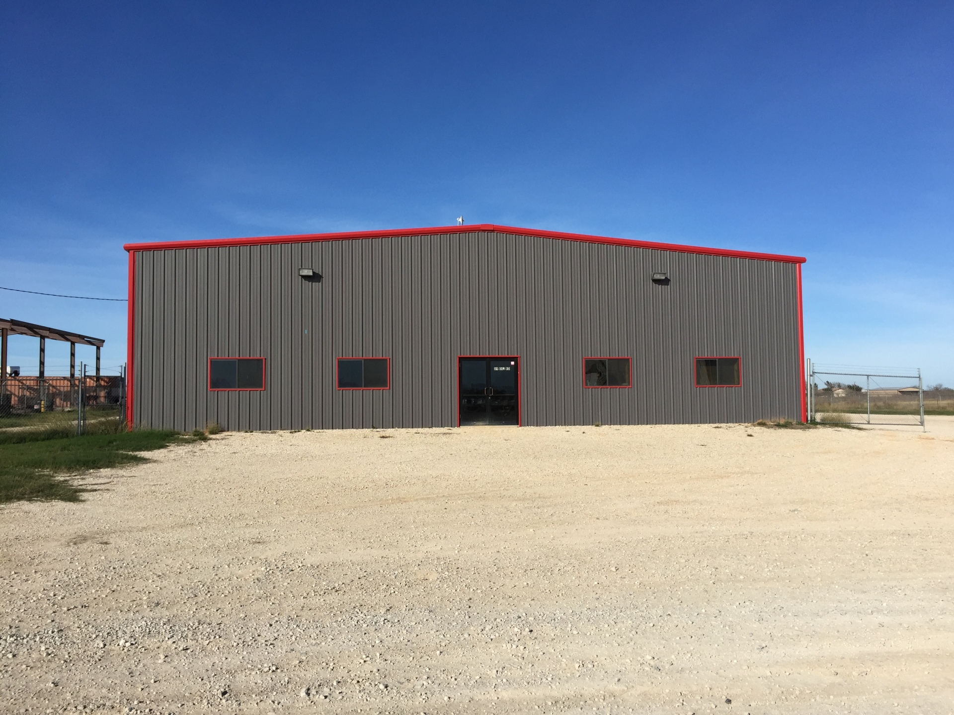 7,600 SF Warehouse on 2 acres in Oil Rd Business District - Pleasanton, TX