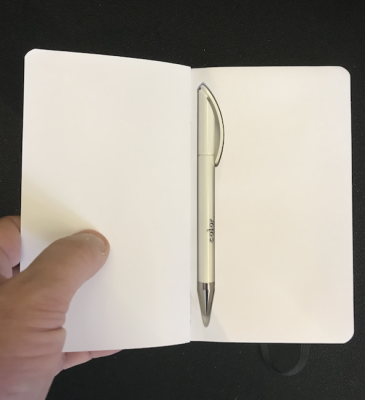 Pad With a hidden pen