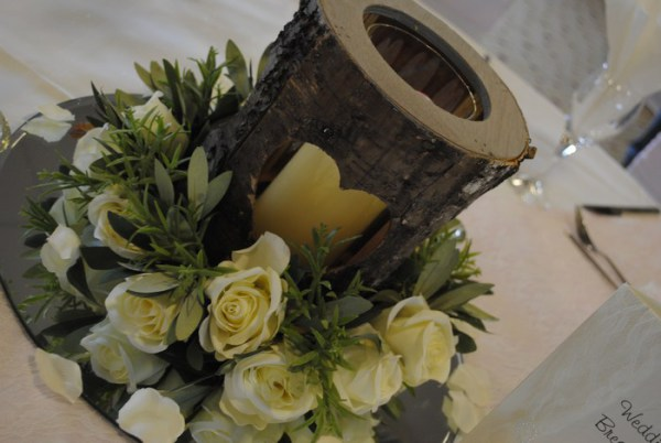 Bark heart vase with cream rose rings and candle