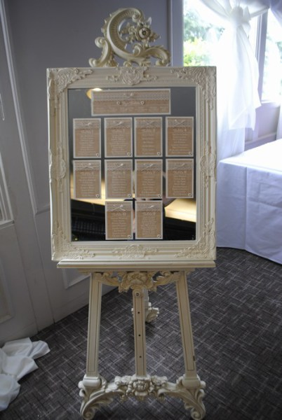 Burlap & lace table plan on a mirror with cream ornate easel