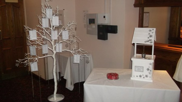 wish tree with snowflake decor and snoflake decorated wooden wishing well hire