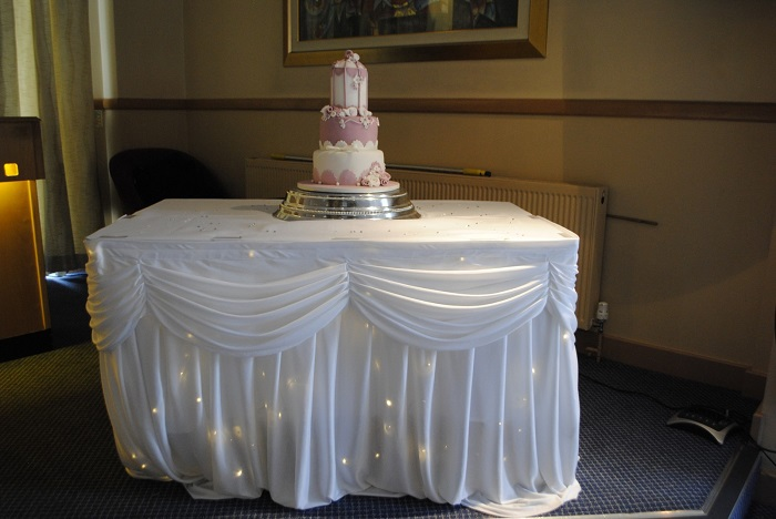 Twinkle cake table skirt hire