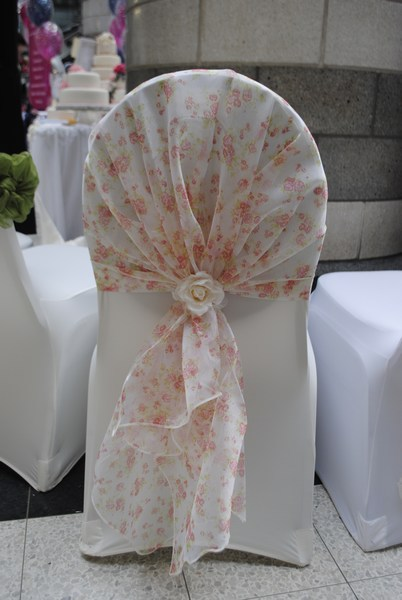 Floral hood chair cover sash hire