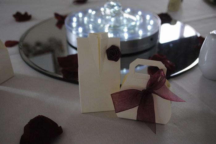 Tuxedo and Handbag favours with burgundy decor