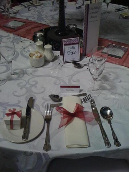 white favour box with burgundy ribbon, matching napkin ribbon