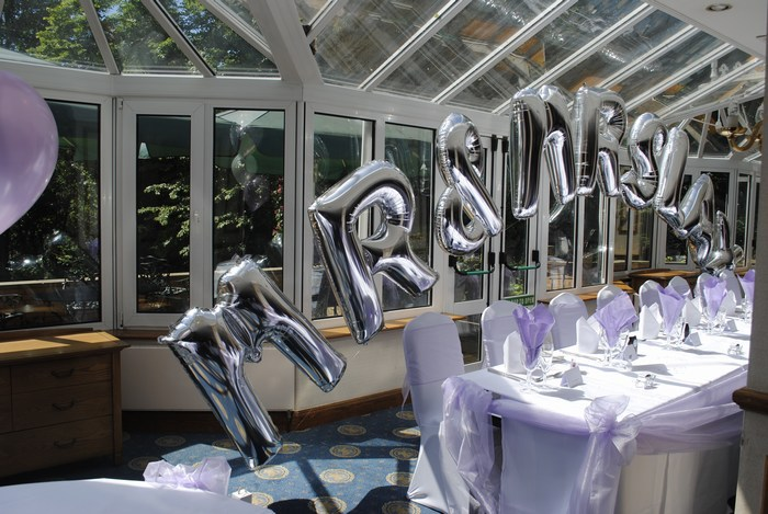 Mr & Mrs foil balloon arch with surname