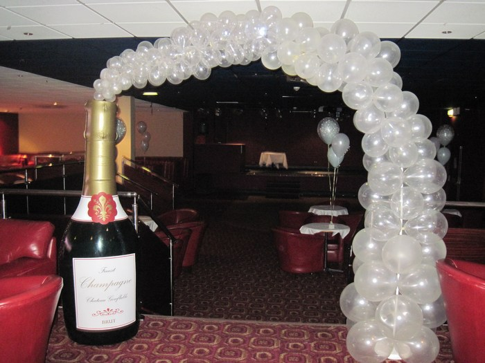 Inflatable champagne bottle arch