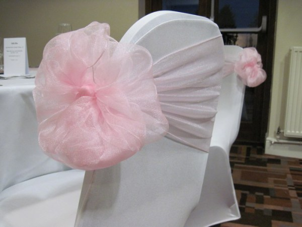 Flower tied chair cover sash hire