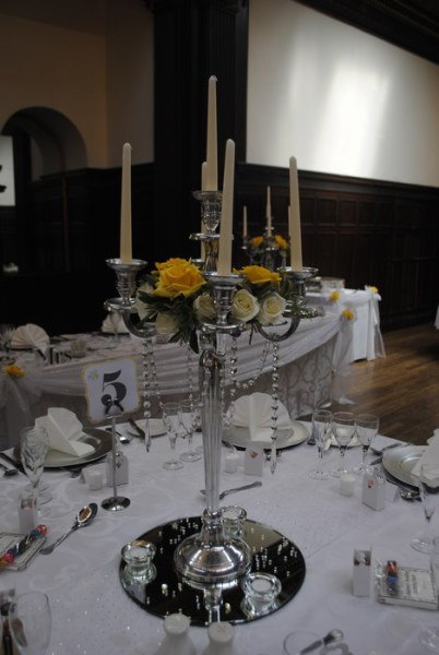 Silver Candelabra with cream & yellow roses and diamante garlands