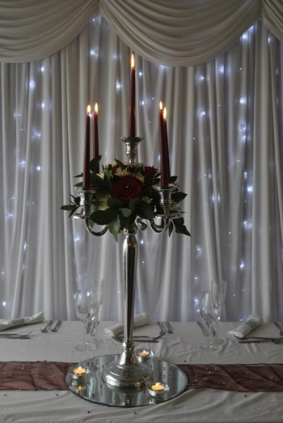 Silver Candelabra with fresh red roses, chrysanthemums, eucalyptus and red candles