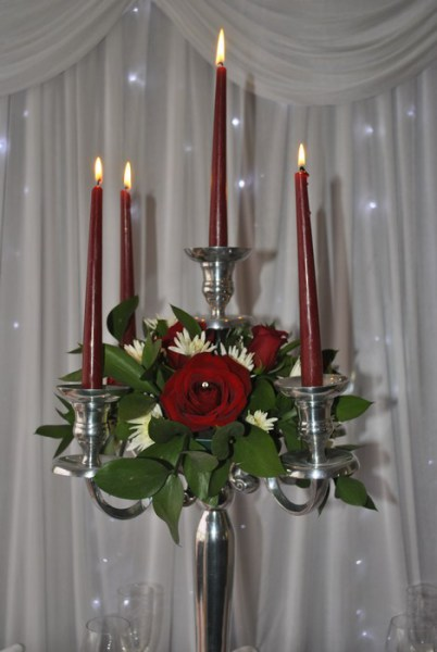 Chrome candelabra with red roses