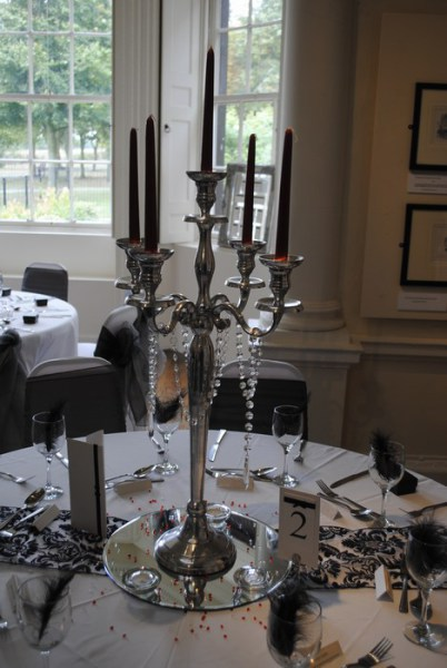 Silver Candelabra with red candles & diamante drapes