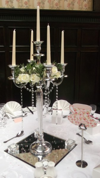 Silver Candelabra with cream roses, diamante garlands, square mirrors & tea lights