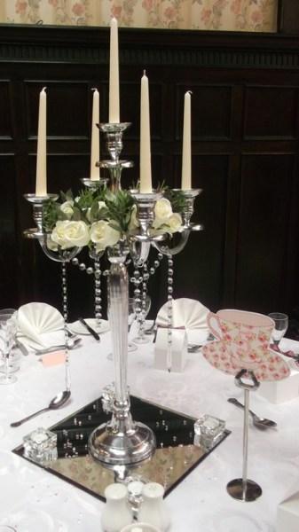 Silver Candelabra with cream roses, diamante garlands, square mirrors & tea lights