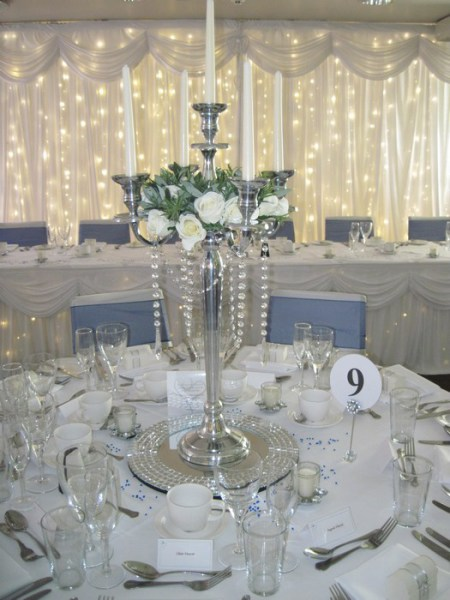 Silver Candelabra with cream rose rings & diamante garland