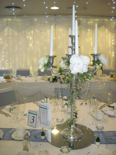 Chrome candelabra with ivy and roses