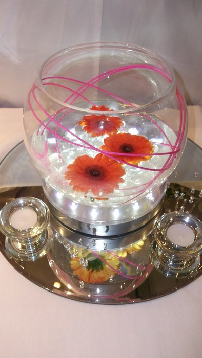 Small Gold Fish Bowls with fresh orange gerbera & hot pink canes