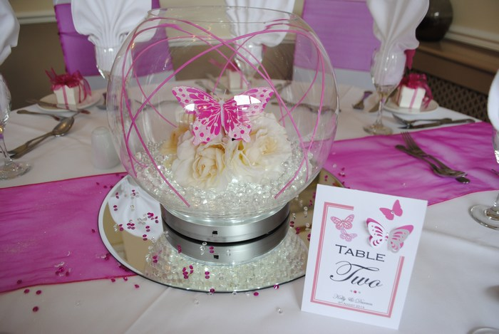 Large Goldfish Bowls cream roses, hot pink canes & butterfly