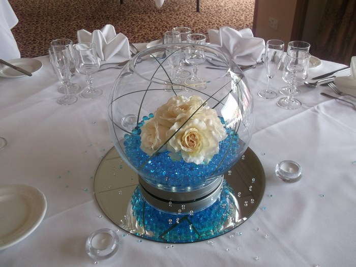 Large Goldfish Bowls cream roses, bear grass, blue crystal pearls