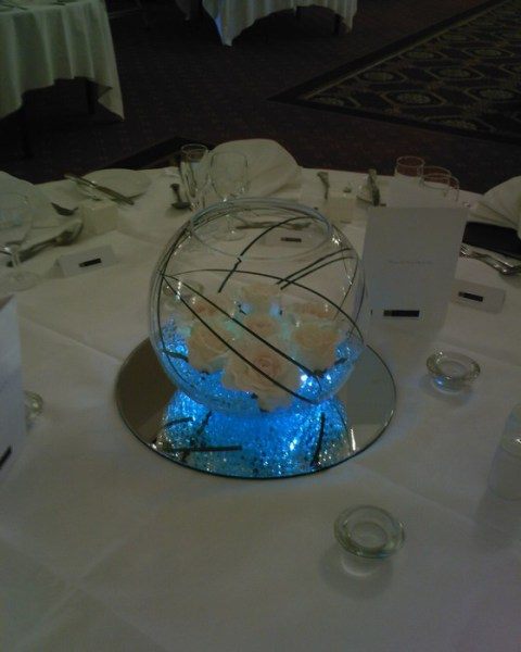 Large Goldfish Bowls with blue crystal pearl, cream roses & bear grass