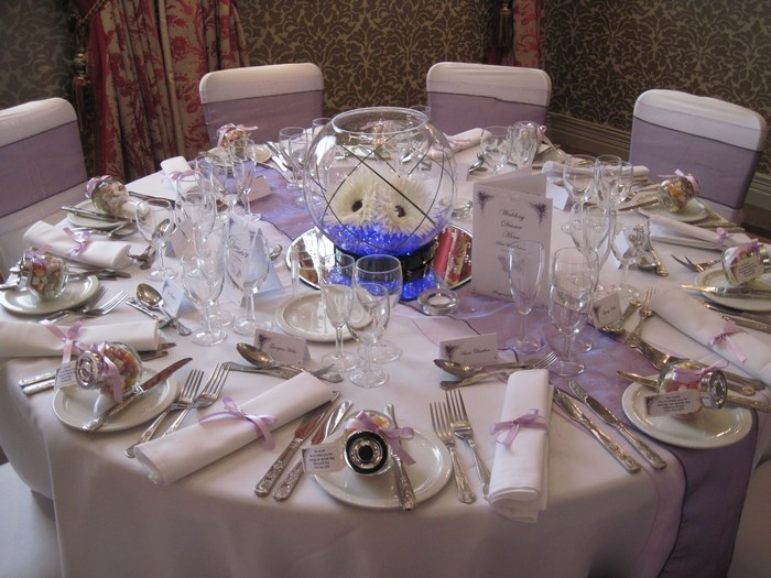 Large Goldfish Bowls with white gerbera, purple crystal pearl & bear grass