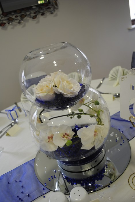 Double Goldfish Bowl cream orchids, cream roses, navy pearls