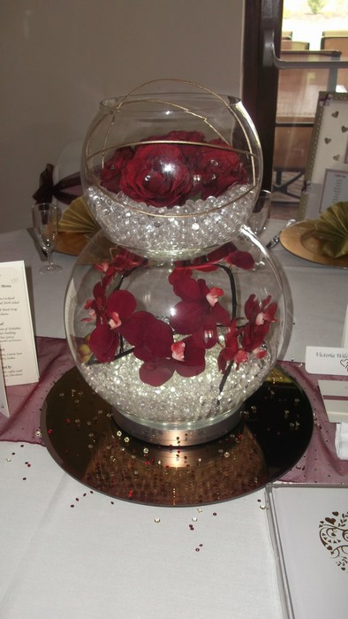 Double Goldfish Bowl dark red orchid, roses and gold canes