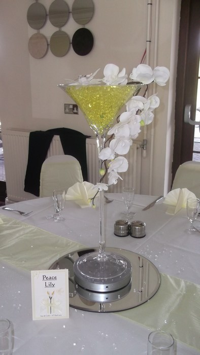 Super Martini draped white orchids, lemon pearls & birds