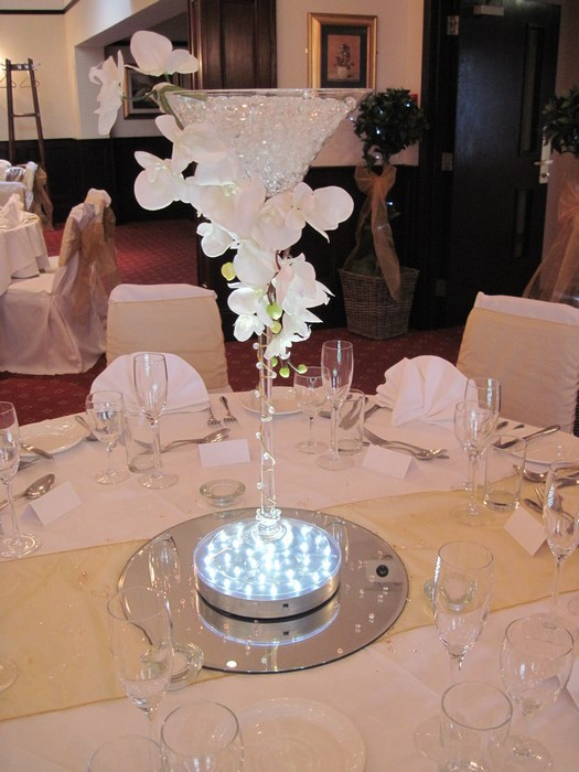 Super Martini draped white orchids
