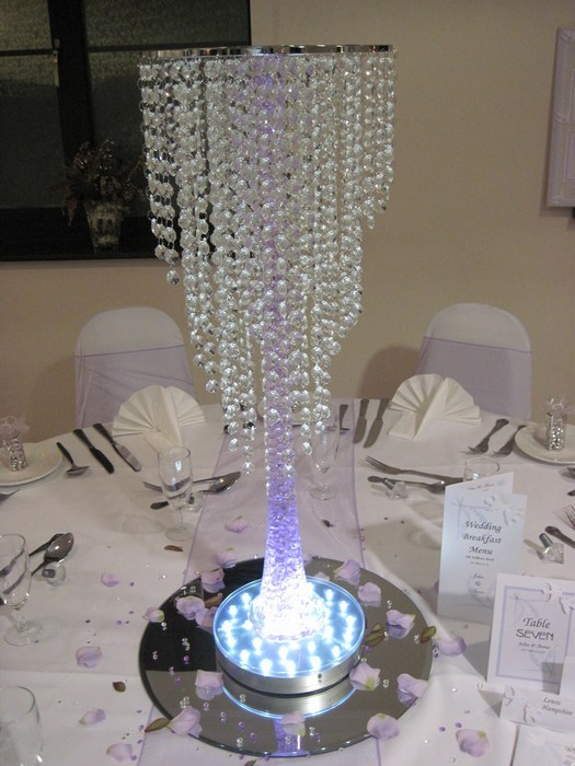 crystal chandelier with blue stem and butterflies