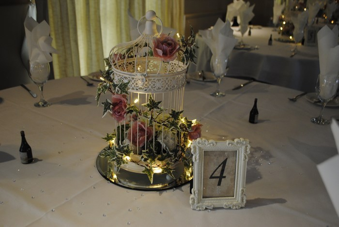 Vintage cream birdcage with pink & cream flower posy & clips