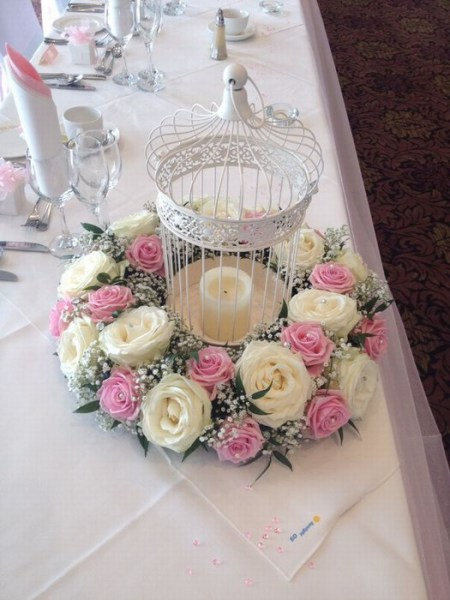 Vintage birdcage with cream and pink roses
