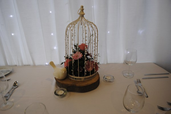 Beaded Birdcage with fresh roses & gerbera & log slice