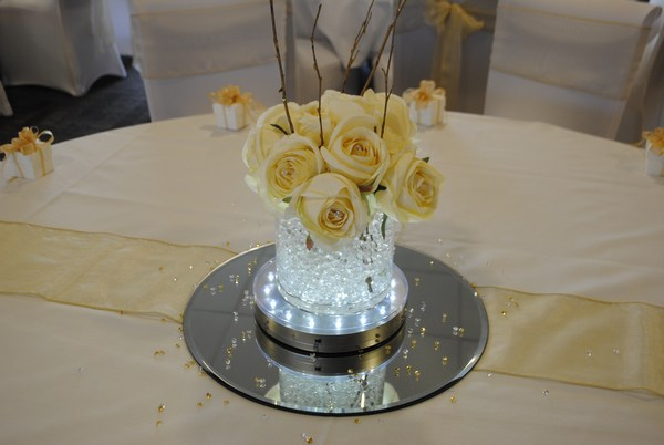Short Cylinder with cream rose posy & rustic sticks