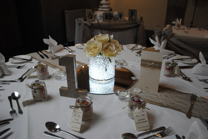 Short Cylinder with cream roses & rustic sticks